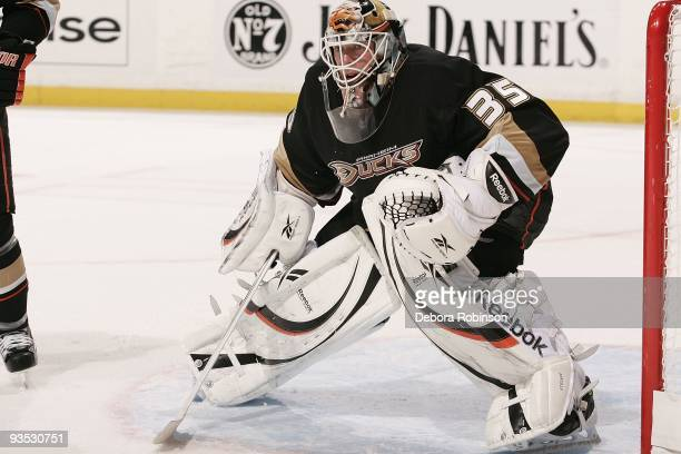 JeanSebastien Giguere of the Anaheim Ducks defends in the crease against the Phoenix Coyotes during the game on November 29 2009 at Honda Center in...