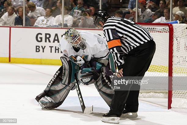 JeanSebastien Giguere of the Mighty Ducks of Anaheim talks with referee Dan Marouelli during a break in the action against the New Jersey Devils in...