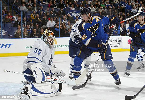 JeanSebastien Giguere of the Toronto Maple Leafs defends against David Backes of the St Louis Blues on February 12 2010 at Scottrade Center in St...