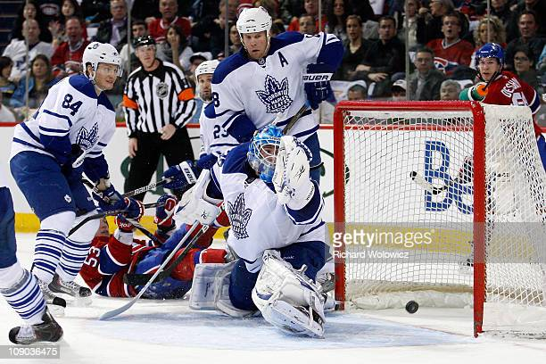 Jean-Sebastien Giguere of the Toronto Maple Leafs lets in a goal on a shot by Benoit Pouliot of the Montreal Canadiens during the NHL game at the...
