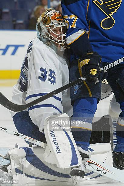 JeanSebastien Giguere of the Toronto Maple Leafs slams into David Perron of the St Louis Blues on February 12 2010 at Scottrade Center in St Louis...