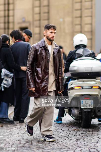 Jean-Sebastien Rocques wears a brown leather jacket, gray flared pants, sneakers, outside Altuzarra, during Paris Fashion Week - Womenswear...
