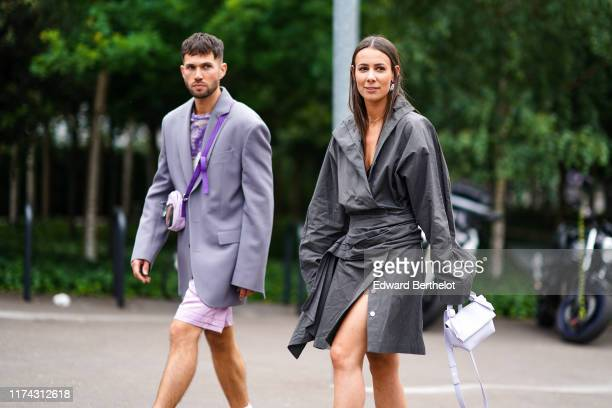 Jean-Sebastien Rocques wears a light grey jacket, a white and purple tie-and-dye top, pale pink shorts, a pale pink and light brown bag ; Alice...