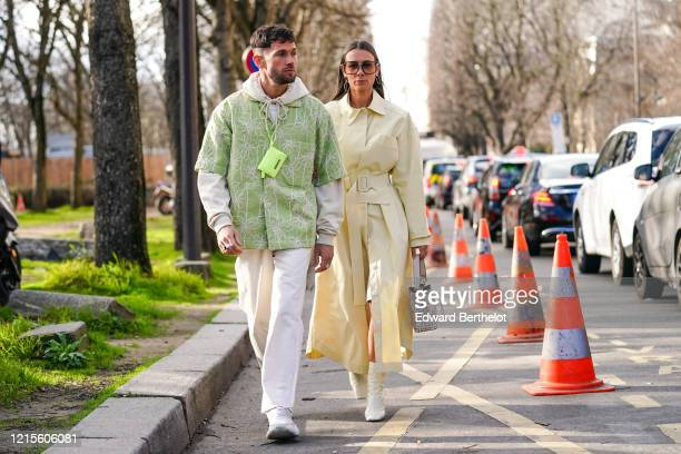 Jean-Sebastien Rocques wears a neon-green Jacquemus mini-bag, rings, a cream-color hooded sweatshirt, a pistachio-green short sleeved shirt with...