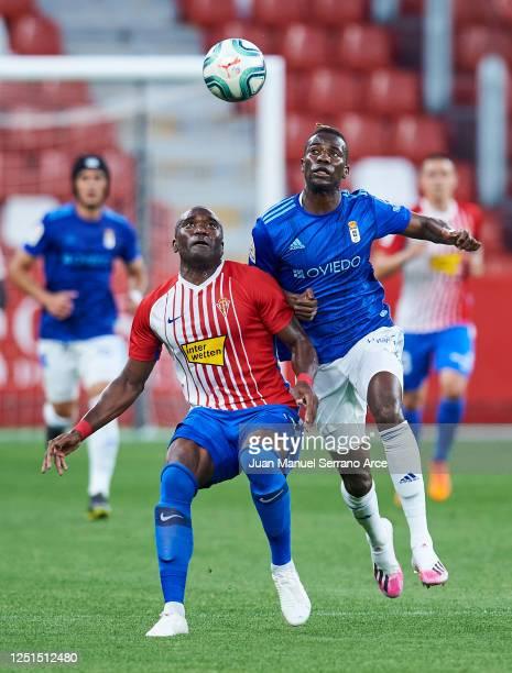 Jean-Sylvain Babin of Sporting de Gijon duels for the ball with Ibrahima Balde of Real Oviedo during the La Liga Smartbank match between Sporting de...