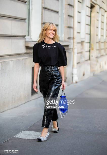 Jeantte Friis Madsen wearing shirt with logo print, black leather pants outside Alessandra Rich during Paris Fashion Week Womenswear Spring Summer...