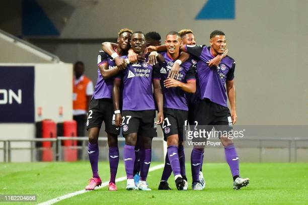 Jean-Victor of Toulouse celebrates his goal with teammates during the Ligue 1 match between Toulouse FC and Dijon FCO at Stadium Municipal on August...