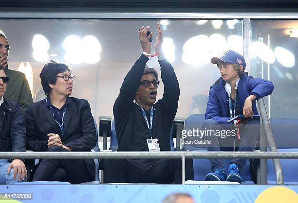 JeanVincent Place Yannick Noah and his son Joalukas Noah attend the UEFA Euro 2016 quarter final match between France and Iceland at Stade de France...
