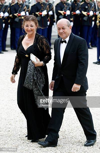 JeanYves Le Drian and his arrive at the Elysee Palace for a State dinner in honor of Queen Elizabeth II hosted by French President Francois Hollande...