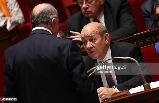 JeanYves Le Drian french Minister of Defence talks to Laurent Fabius french Minister of Foreign Affairs during the Questions to the Government at the...