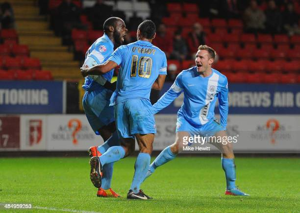 JeanYves Mvoto of Barnsley celebrates scoring the opening goal with Chris O'Grady and Liam Lawrence of Barnsley during the Sky Bet Championship match...