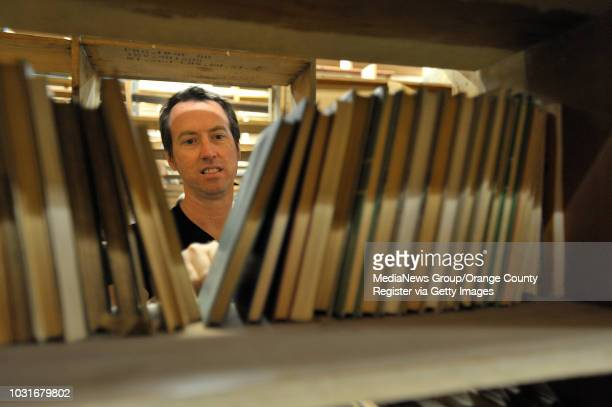 USA JeanYves Tessier searches for books during Acres of Books' last hurrah in Long Beach CA on July 10 2010 The ArtExchange who now owns the iconic...