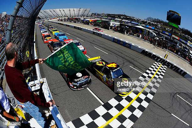 Jeb Burton driver of the Arrowhead Chevrolet and Darrell Wallace Jr driver of the Toyota Care Toyota lead the field past the green flag to start the...