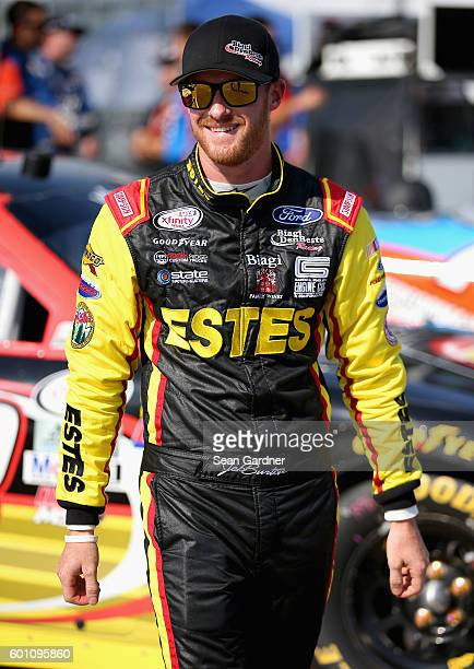 Jeb Burton driver of the Estes Ford walks down pit road during qualifying for the NASCAR XFINITY Series Virginia529 College Savings 250 at Richmond...