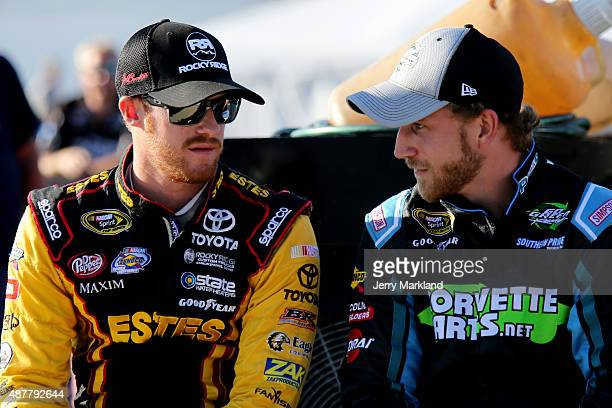 Jeb Burton driver of the Estes Toyota talks with Jeffrey Earnhardt driver of the BeerFrostcom/CorvettePartsnet Ford on pit road during qualifying for...