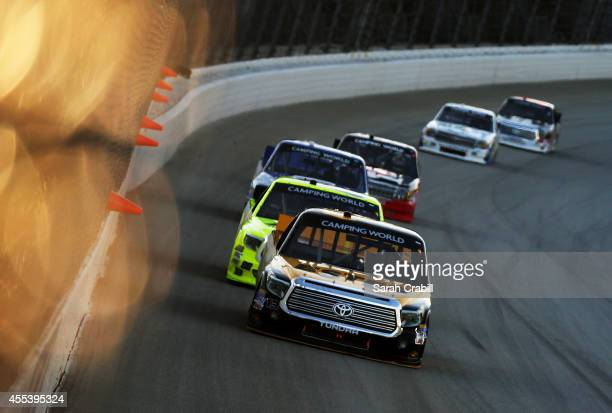 Jeb Burton driver of the Estes/Carolina Nut Company Toyota leads a pack of trucks during the NASCAR Camping World Truck Series Lucas Oil 225 at...