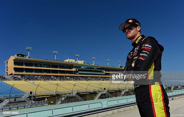 Jeb Burton driver of the Estes/Carolina Nut Company Toyota stands on pit road during practice for the NASCAR Camping World Truck Series Ford EcoBoost...