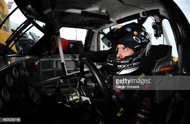 Jeb Burton driver of the EstesCarolina Nut Toyota sits in his car during practice for the American Ethanol 200 at Iowa Speedway on July 11 2014 in...