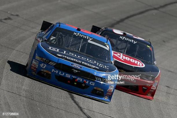 Jeb Burton driver of the J Streicher Ford races Ty Dillon driver of the Rheem Chevrolet during the NASCAR XFINITY Series Heads Up Georgia 250 at...