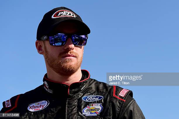 Jeb Burton driver of the J Streicher Ford stands on the grid during qualifying for the NASCAR XFINITY Series PowerShares QQQ 300 at Daytona...