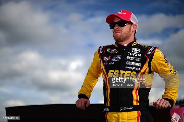 Jeb Burton driver of the Maxim Fantasy Sports Toyota stands on the grid during qualifying for the NASCAR Sprint Cup Series Axalta 'We Paint Winners'...