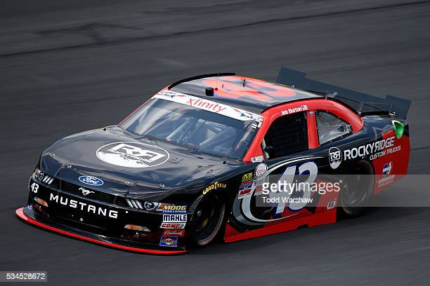 Jeb Burton driver of the Rocky Ridge Custom Trucks Ford practices for the NASCAR XFINITY Series Hisense 4K TV 300 at Charlotte Motor Speedway on May...