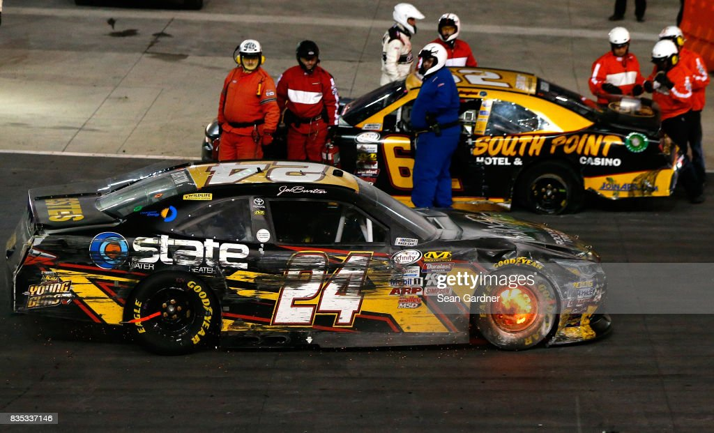 Jeb Burton, driver of the #24 WBWF/State Water Heaters Toyota, and Brendan Gaughan, driver of the #62 South Point Hotel & Casino Chevrolet, site on the track after a wreck during the NASCAR XFINITY Series Food City 300 at Bristol Motor Speedway on August 18, 2017 in Bristol, Tennessee.