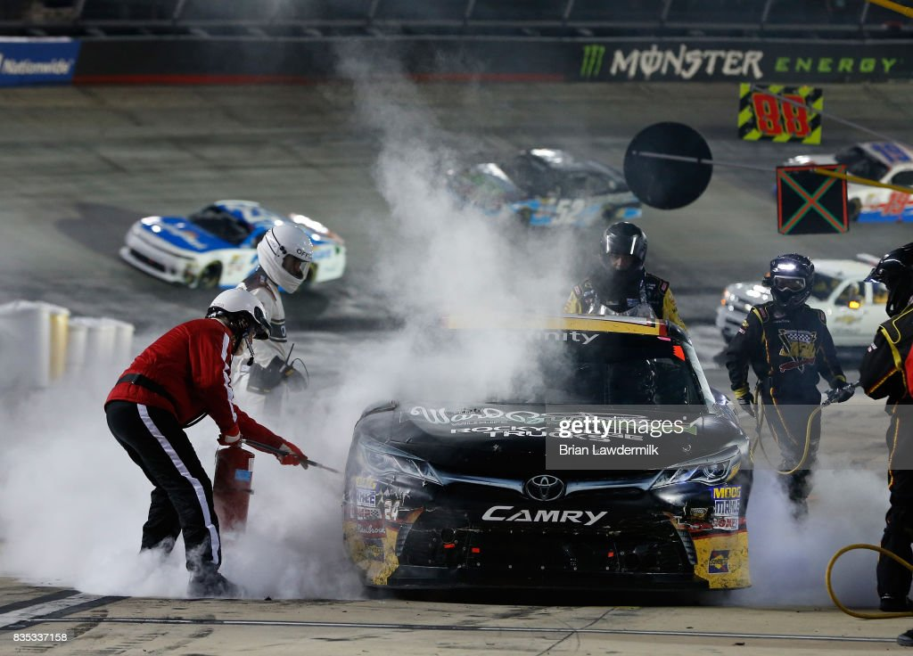 Jeb Burton, driver of the #24 WBWF/State Water Heaters Toyota, smokes on pit lane during the NASCAR XFINITY Series Food City 300 at Bristol Motor Speedway on August 18, 2017 in Bristol, Tennessee.