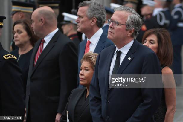 Jeb Bush and his wife Columba watch as the casket of President George H.W. Bush is carried from St. Martin's Episcopal Church following his funeral...