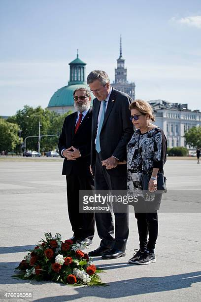 Jeb Bush former governor of Florida center and his wife Columba Bush right hold hands after laying a wreath with members of Polish American Freedom...