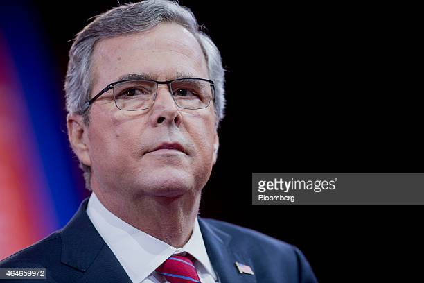 Jeb Bush former governor of Florida listens to a question during an interview with Sean Hannity host of the Sean Hannity Show at the Conservative...