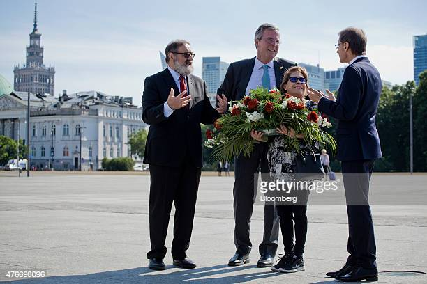 Jeb Bush former governor of Florida second left lays a wreath with his wife Columba Bush second right and members of Polish American Freedom...