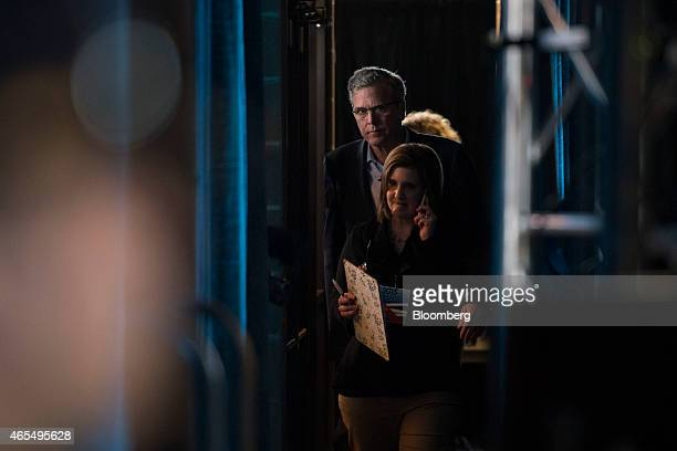 Jeb Bush former governor of Florida walks backstage prior to speaking at the Iowa Ag Summit at the Iowa State Fairgrounds in Des Moines Iowa US on...