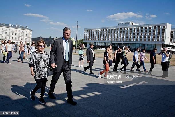 Jeb Bush former governor of Florida walks with his wife Columba Bush in Pilsudski Square in Warsaw Poland on Thursday June 11 2015 Bush is on a...