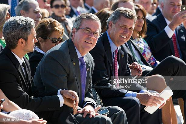 Jeb Bush left and Marvin Bush brothers of George W Bush attend the dedication of the George W Bush presidential library on the campus of Southern...