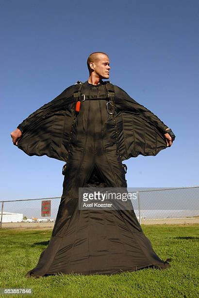 Jeb Corliss shows one of his wingsuits at Perris Valley Skydiving complex Corliss has developed a 'wingsuit' to try to skydive and land without a...
