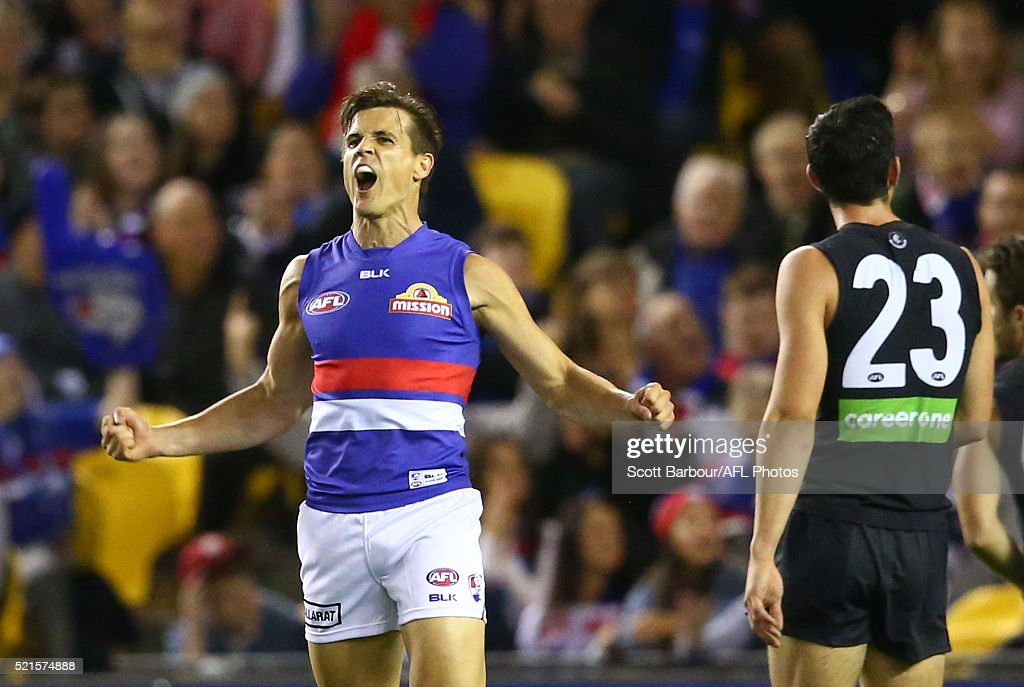 Jed Adcock of the Bulldogs celebrates after kicking a goal during the round four AFL match between the Carlton Blues and the Western Bulldogs at Etihad Stadium on April 16, 2016 in Melbourne, Australia.