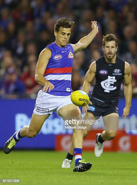 Jed Adcock of the Bulldogs kicks the ball for a goal during AFL Round 4 match between the Carlton Blues and the Western Bulldogs at Etihad Stadium on...