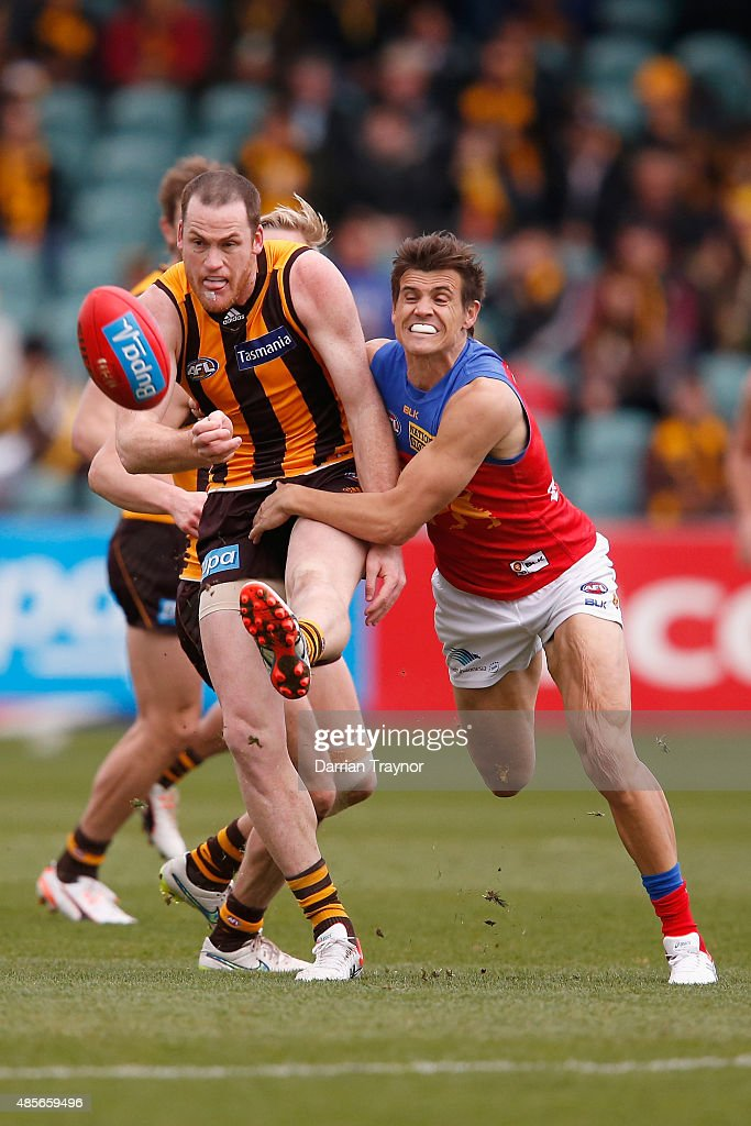 Jed Adcock of the Lions tackles Jarryd Roughead of the Hawks during the round 22 AFL match between the Hawthorn Hawks and the Brisbane Lions at Aurora Stadium on August 29, 2015 in Launceston, Australia.