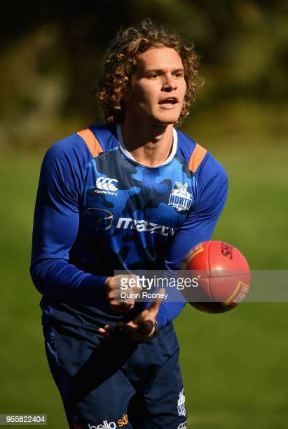 Jed Anderson of the Kangaroos handballs during a North Melbourne Kangaroos AFL training session at Catani Gardens on May 8 2018 in Melbourne Australia