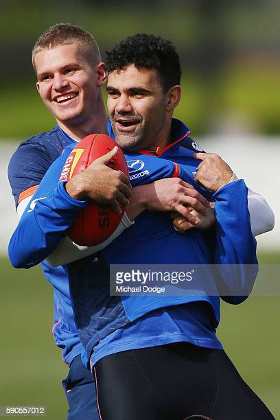 Jed Anderson tackles high Lindsay Thomas of the Kangaroos who reacts during a North Melbourne Kangaroos AFL training session at Arden Street Ground...