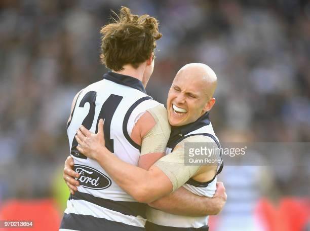 Jed Bews and Gary Ablett of the Cats celebrate a goal during the round 12 AFL match between the Geelong Cats and the North Melbourne Kangaroos at...