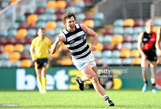 Jed Bews of the Cats celebrates kicking a goal during the round 16 AFL match between the Geelong Cats and the Essendon Bombers at The Gabba on...