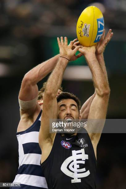Jed Bews of the Cats spoils Kade Simpson of the Blues during the round 19 AFL match between the Carlton Blues and the Geelong Cats at Etihad Stadium...