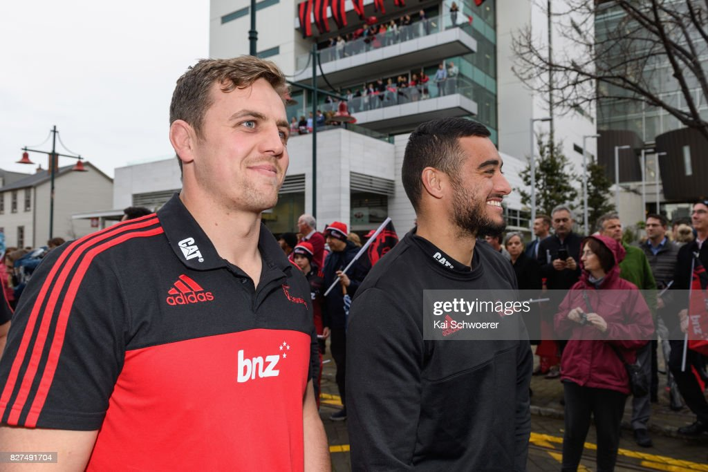 Jed Brown and Bryn Hall of the Crusaders (L-R) greet fans during a parade at Christchurch Art Gallery on August 8, 2017 in Christchurch, New Zealand. The Crusaders beat the Lions to win the 2017 Super Rugby Final on Saturday night in Johannesburg.