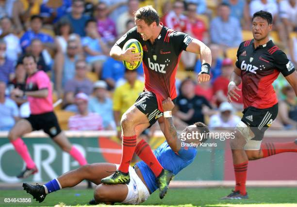 Jed Brown of the Crusaders breaks through the defence during the Rugby Global Tens match between the Crusaders and Somoa at Suncorp Stadium on...