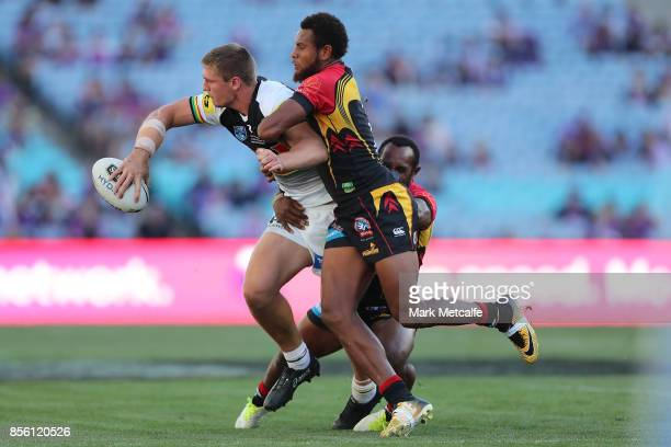 Jed Cartwright of the Panthers is tackled during the 2017 State Championship Final between the Penrith Panthers and Papua New Guinea Hunters at ANZ...