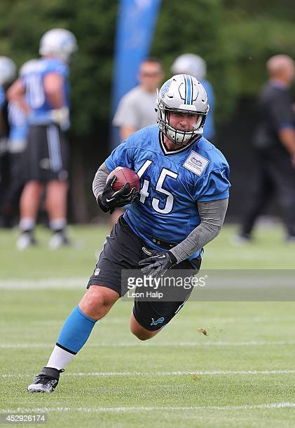 Jed Collins of the Detroit Lions goes through the drills during training camp at the Detroit Lions training facility on July 29 2014 in Allen Park...