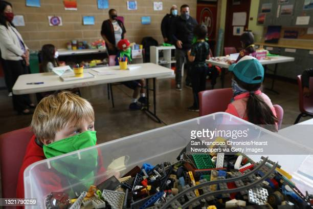 Jed Cushing plays with legos in the learning hub inside the Minnie and Lovie Ward Recreation Ctr. On Thursday, July 23 in San Francisco, Calif.