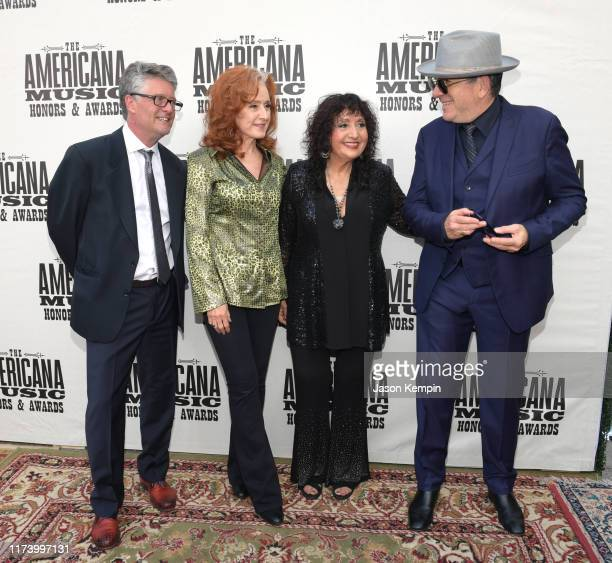 Jed Hilly Bonnie Raitt Maria Muldaur and Elvis Costello attend the 2019 Americana Honors Awards at Ryman Auditorium on September 11 2019 in Nashville...